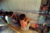 Children works as weavers of Afghan carpets in an illegal ...