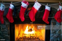 Christmas Stockings Hanging Over Fireplace Stock Photo ...