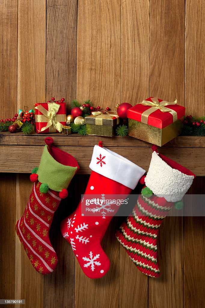Close Up On Christmas Tree And Stocking Hanging On Fireplace Stock Stocking Stock Photos And Pictures | Getty Images