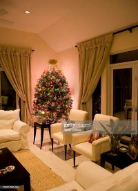 Christmas Tree On Table In Living Room Stock Photo | Getty ...
