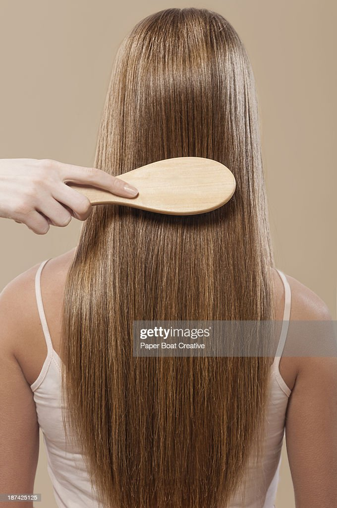 close of hair brushing straight