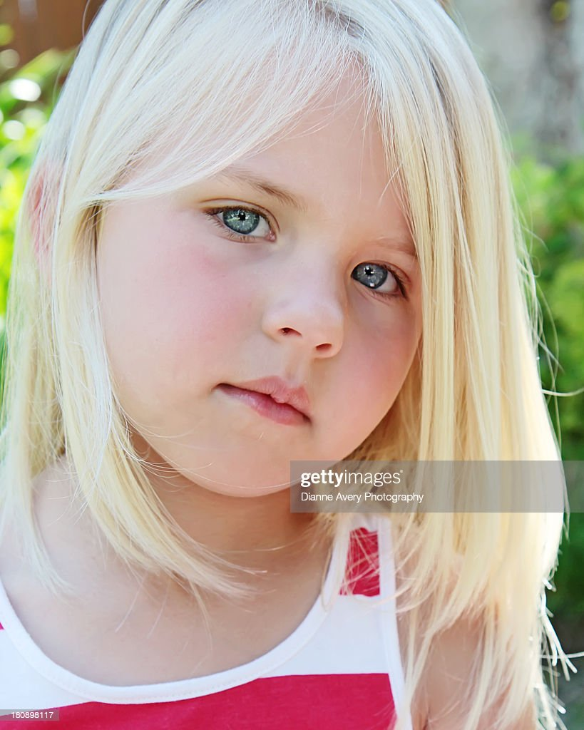 Close Up Of Serious Young Blue Eyed Girl Stock Photo