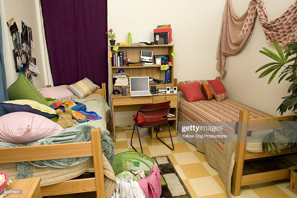 College Dorm Room Of Neat And Messy Roommates Stock Photo