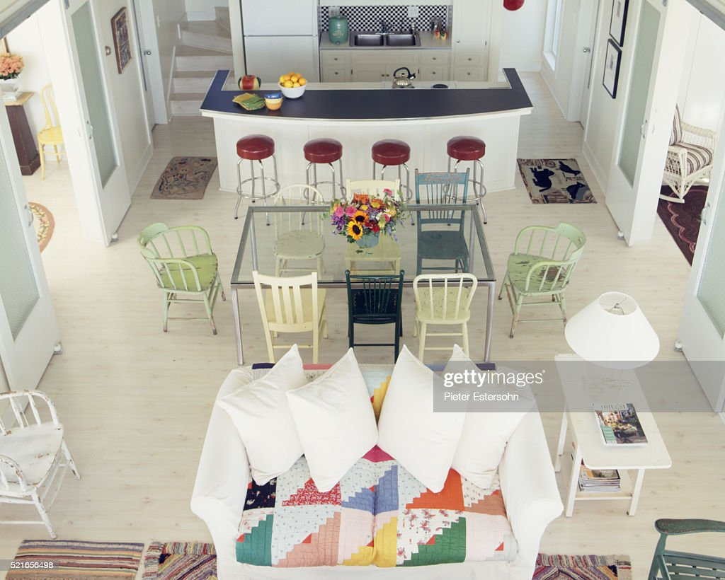 colorful kitchen table fruit basket and living room with island dining quilt upholstered couch stock photo