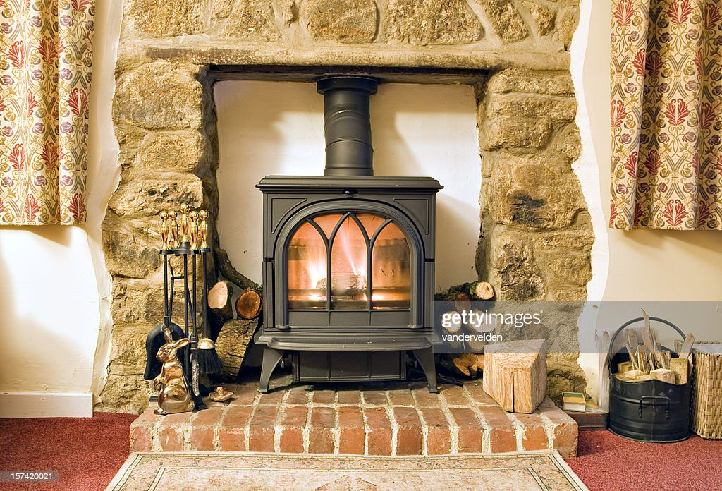 images of living rooms with wood burning stoves how to make my own room furniture stove stock photos and pictures cottage fire rf home showcase interior fireplace