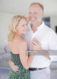 Couple Dancing In Living Room Stock Photo