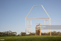 Couple In Doorway Of House Outline Stock Photo