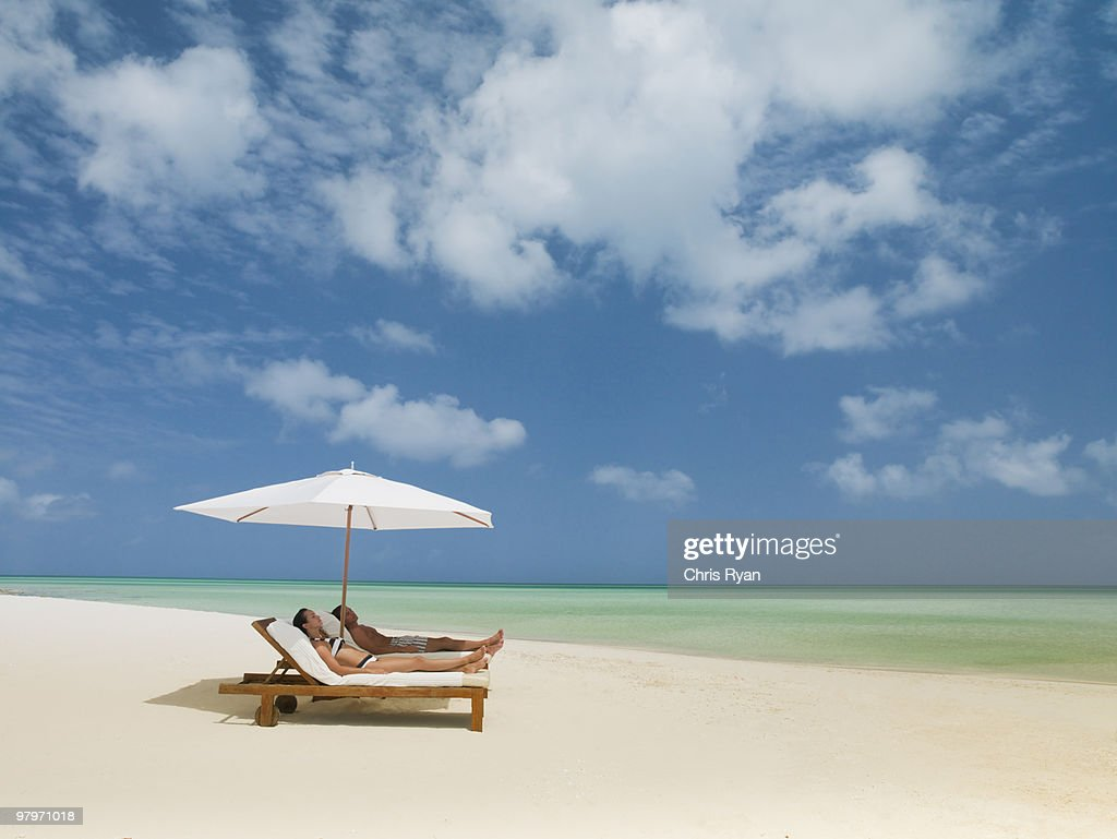 lay down beach chairs hammock chair stand home depot couple on laying lounge under