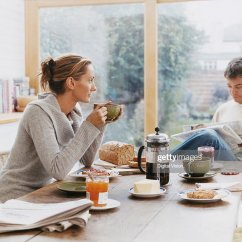 Adult Saucer Chair Rolling Dining Chairs Couple Sits At A Kitchen Table Having Breakfast Stock Photo | Getty Images