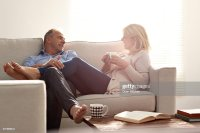 Couple Talking In Living Room With Coffee Stock Photo