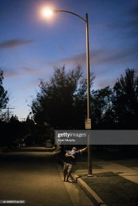 Drunk Man Leaning On Lamp Post At Night Stock Photo ...
