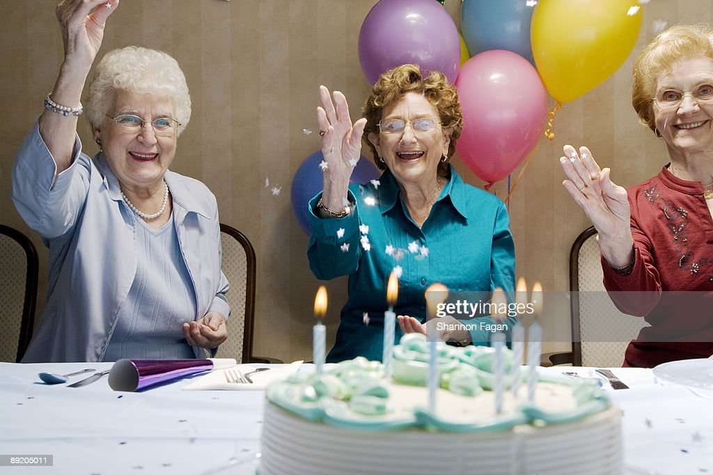 Elderly Women At Birthday Party With Decorations High Res