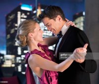 Elegant Couple Dancing In Living Room Stock Photo | Getty ...