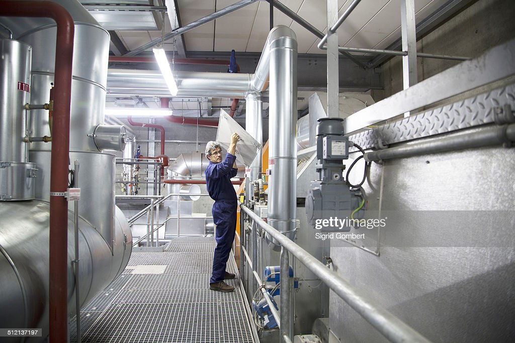 Engineer Removing Cover From Equipment In Power Station StockFoto  Getty Images