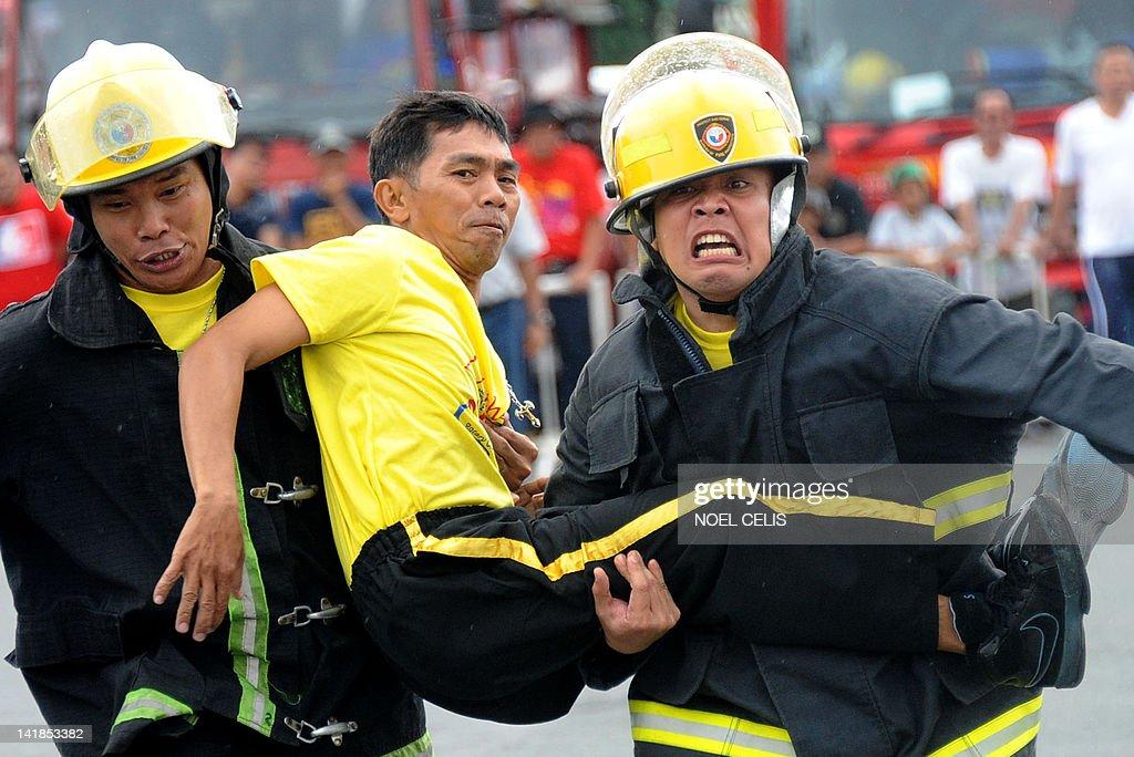 firemen carry a mock