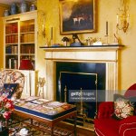 Fireplace And Builtin Bookcase In Living Room With Yellow