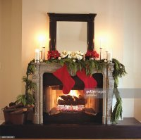 Fireplace Decorated With Christmas Stockings And ...
