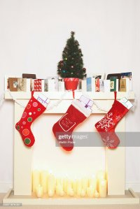 Fireplace Filled With Candles With Stockings Cards And ...