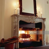 Fireplace With Candles On Mantle Stock Photo | Getty Images