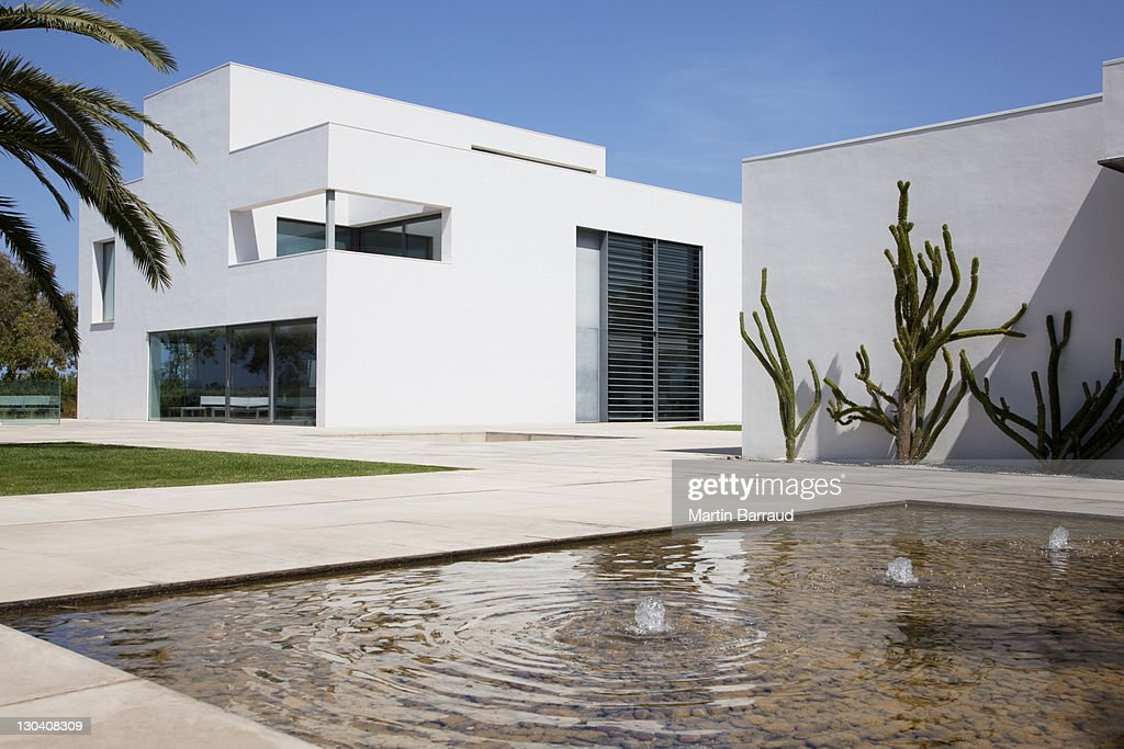 Fountain In Courtyard Of Modern House Stock Photo