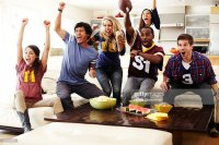 Friends Watching Football In Living Room Stock Photo ...