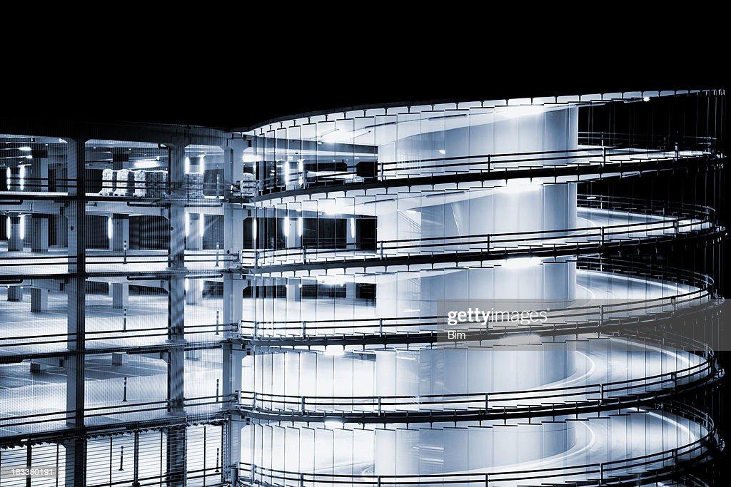 Futuristic Spiral Ramp Multi Storey Car Park Illuminated