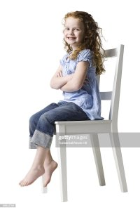 Girl Sitting In A Chair Stock Photo | Getty Images