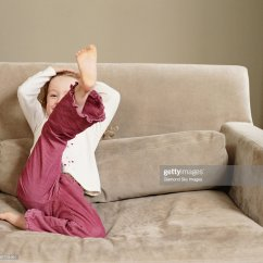 Sofa With Legs Or Without Minnie Mouse Bed Girl Sitting On Leg In Air Smiling Portrait Stock