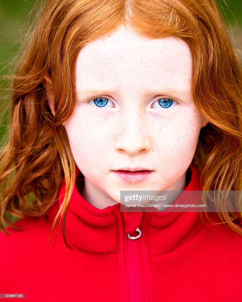 girl with red hair and blue eyes