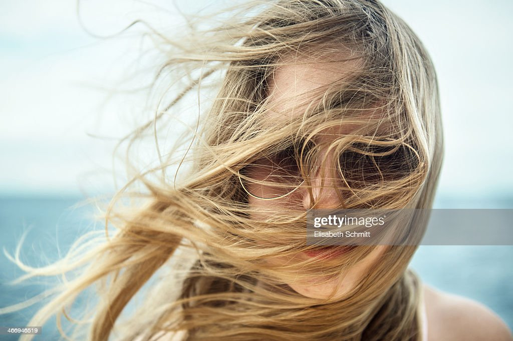 girl with sunglasses hair blowing