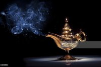A Gold Genie Lamp With Smoke On Black Background Stock ...