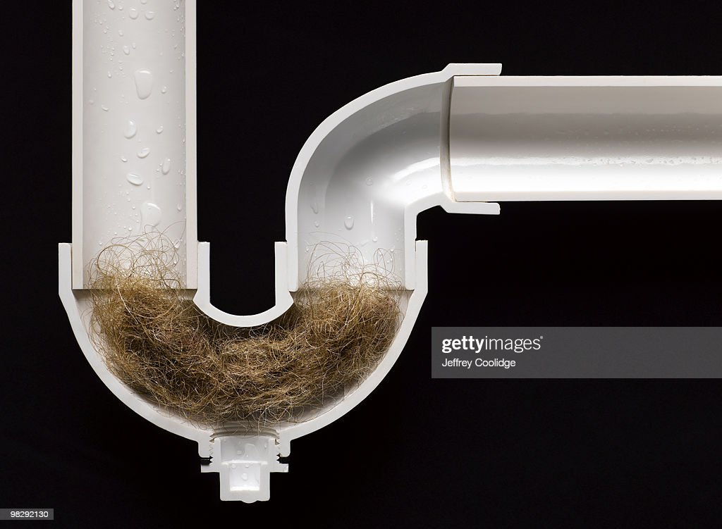 Hair Ball Clog In Drain Pipe Stock Photo  Getty Images