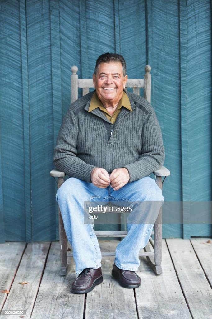 reading chairs uk red office chair no wheels old man rocking stock photos and pictures | getty images