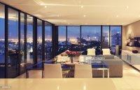 Illuminated Modern Living Room Overlooking City Stock ...