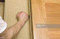 Installer Cutting Carpet Stair Tread Near Hardwood Landing ...