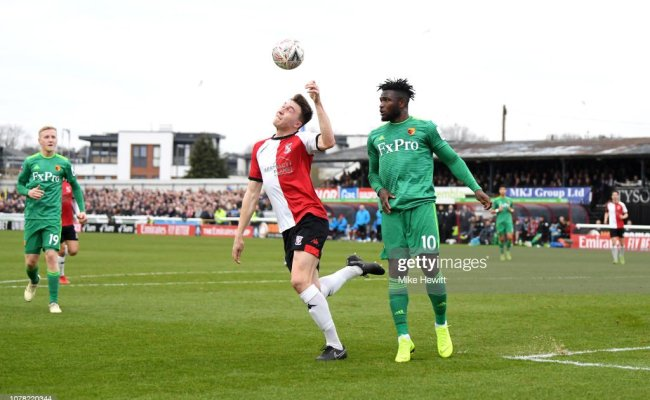 Jack Cook Of Woking Is Fouled By Isaac Success Of Watford