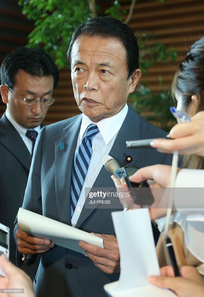 Japanese Finance Minister Taro Aso speaks to reporters after an... News Photo - Getty Images