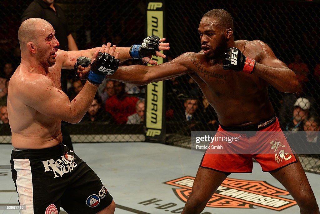jon bones jones punches glover teixeira in their light heavyweight picture id486981715