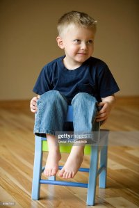 Little Boy Sitting On A Chair Stock Photo | Getty Images