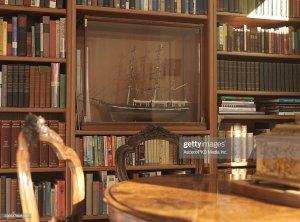 table living background bookshelf chairs knick knack res shelf bottle ship knacks royalty premium gettyimages rm