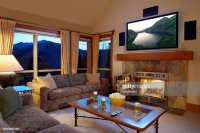 Living Room With Flat Screen Television Above Fireplace