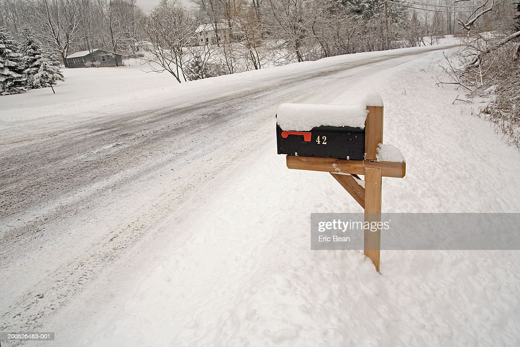 mailbox covered in snow roadside