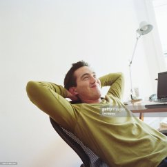Office Chair Leaning To One Side Target Chairs Dining Man Back In Smiling Stock Photo Getty Images