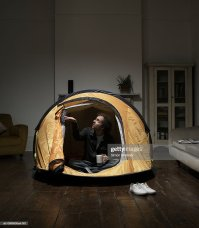 Man Sitting In Tent In Living Room Stock Photo | Getty Images