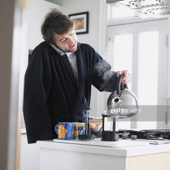 Kitchen Phone Rentals Man Standing In Using Pouring Water Into Coffee Plunger Stock Photo