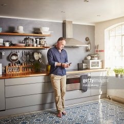 Kitchen Phone Discount Curtains A Man Stands In His Using Mobile Stock Photo Getty