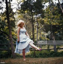 Marilyn Monroe Frolicking In Grass Barefoot Blue