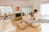 Mature Couple Talking In Living Room Stock Photo