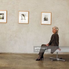Sofa Art Gallery Tan Leather Corner Sofas Uk Mature Woman Sitting On In Stock Photo Getty Images