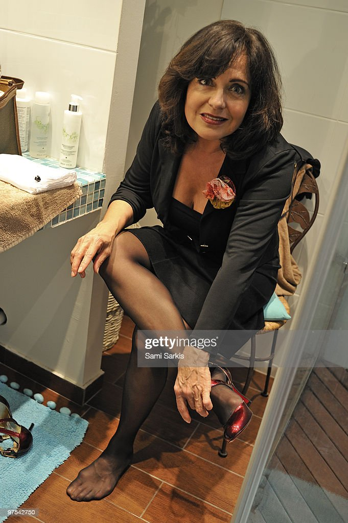 high chair upside down eames molded plywood lounge with wood base sexy mature women in heels stock photos and pictures   getty images